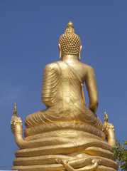 Back of golden Buddha statue in Phuket, Thailand