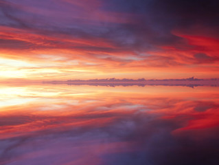 Reflection of dramatic and colorful clouds