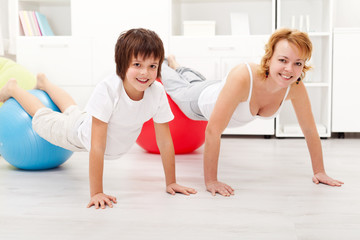 Happy woman exercising with her son