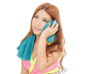Attractive Asian woman drying with towel after exercise