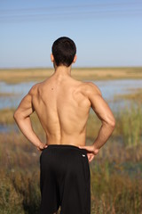 male bodybuilder model back view. background