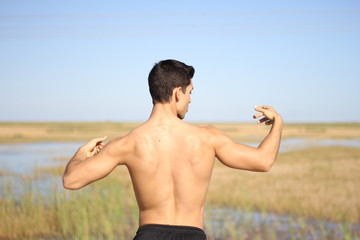 male bodybuilder model back view.