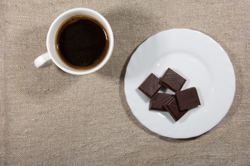 Cup of coffee with chocolate on the saucer