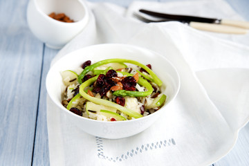 Rice salad with apples, cranberries and nuts