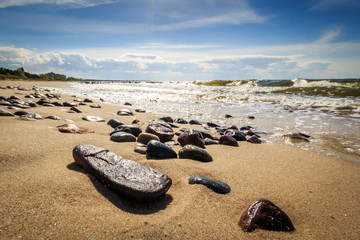 Pebbles on the beach shining in the sun