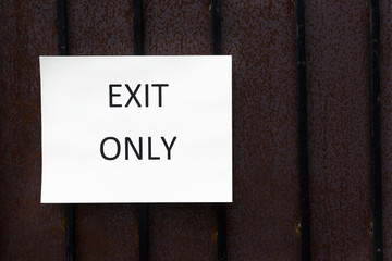 Exit Only Sign on Wood Panel