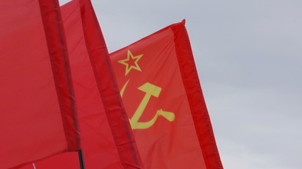 Soviet flag flying. Red flags in the wind.