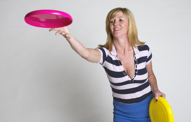Woman throwing a frisbee disc