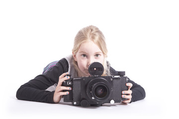 young girl with large old fashioned camera in studio