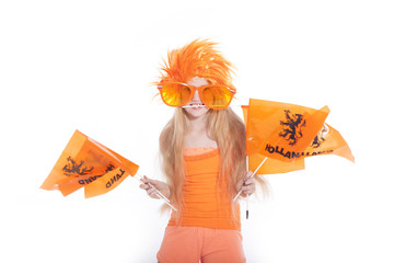 young girl with orange wig and glasses waving flags
