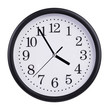 Office clock shows five minutes to four