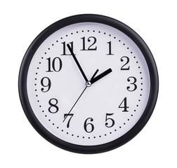 Office clock shows five minutes to two