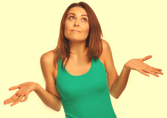 woman throws her hands she did not understand surprised looks up