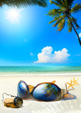 Fototapety Art romantic sea beach. Women's Glasses and Champagne cork on sa