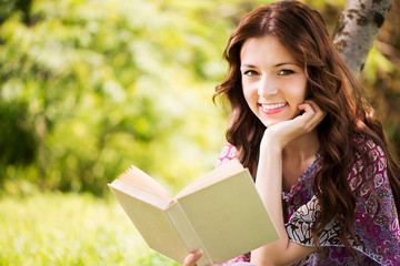 Portrait of Girl with a book in the park