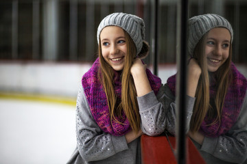 Cute teenage girl ice skating