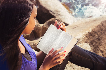 Young Girl Studying Her Bible Outdoors