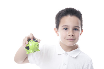 Child with piggy bank. Isolated on white.