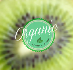 Organic food retro label kiwi blurred background