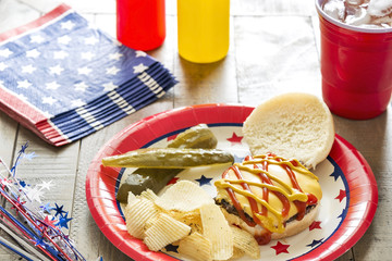 Cheeseburger with ketchup and mustard at a patriotic BBQ