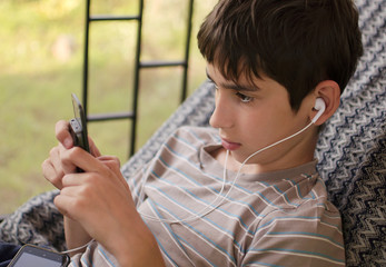 Teen listens music through headphones