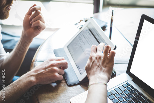 canvas print picture close up of hand using tablet and notebook