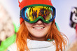 Happy young woman in ski mask with reflection
