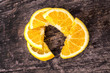 orange slices on wood background