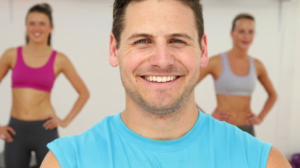 Aerobics instructor smiling at camera