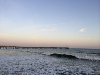 Long wooden pier stretching in ocean, Ventura, CA
