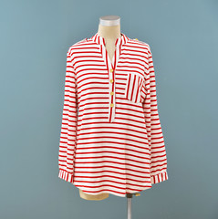 female stripy clothes on a mannequin in blue background
