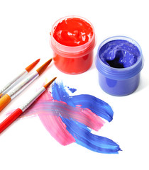 Abstract gouache paint, cans  and brushes, isolated on white