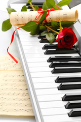 background of piano keyboard with flower