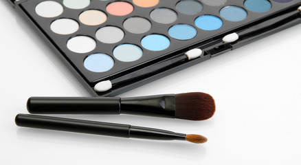 shadow kit with brushes for make-up isolated on white