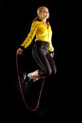 fitness girl in sport with a skipping rope