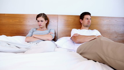 Unhappy couple not talking after argument