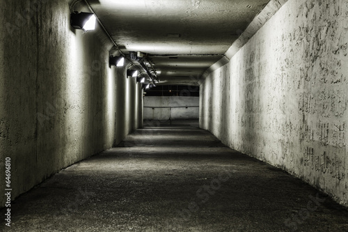 Empty tunnel at night - 64696810
