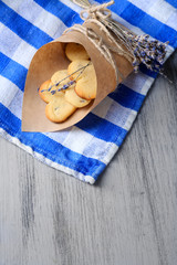 Lavender cookies in paper bag, on color napkin background