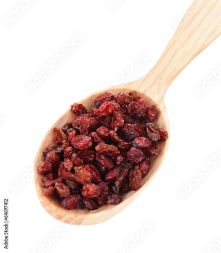 Spice barberry in wooden spoon isolated on white
