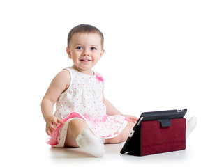 baby girl playing with a digital tablet