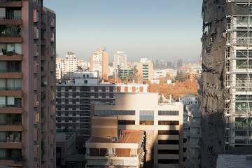 City viewed through middle of two buildings, Santiago, Chile