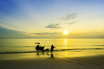 fisherman at beach via great sunrise