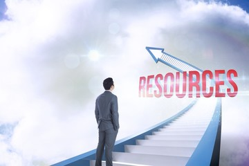 Resources against red staircase arrow pointing up against sky