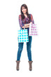 Beautiful young woman with colorful shopping bags