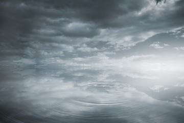 Rippling water under dark sky