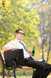 Relaxed businessman taking a break in park