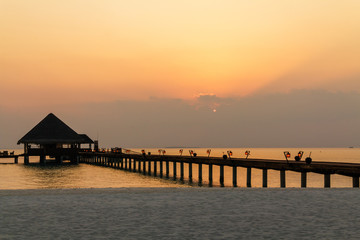 Scenery of hte calm dusk with a long bridge,Maldives