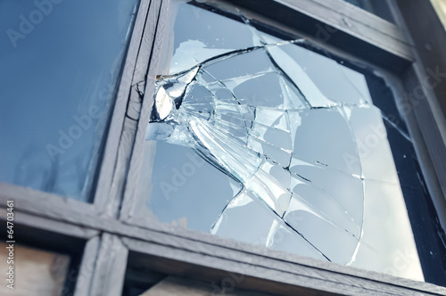 broken glass in a window frame - 64703461