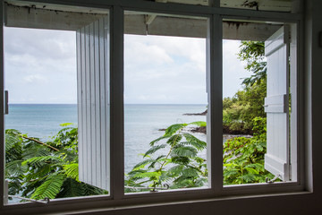 View of Tropical Sea Through Old Wood Window