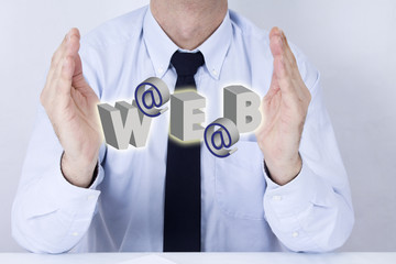 Businessman in office with computer terms